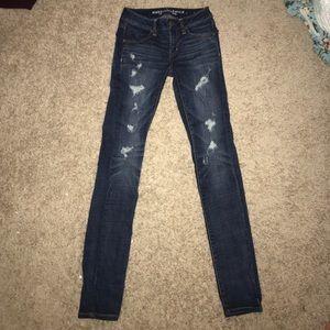 AE dark wash destroyed jeans